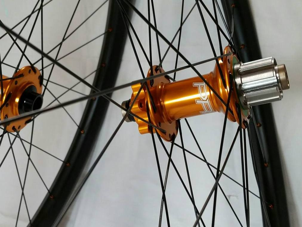 Hope Pro4 single speed hubs in orange on Light Bicycle carbon rims